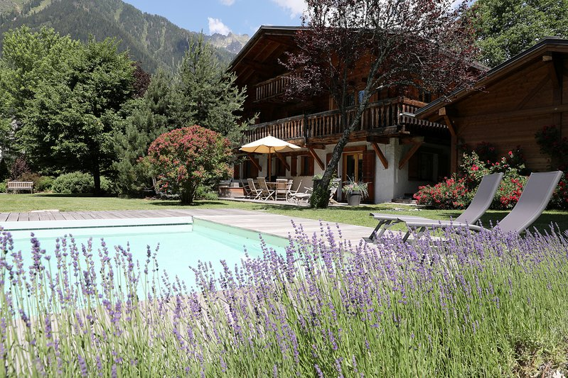 The outdoor pool and exterior of the Chalet toward Brevent